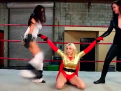 Heroines fight villainess's in sexy wrestling match.
