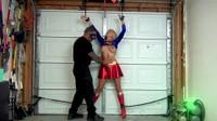 Villain Gropes Super Girl In A Garage
