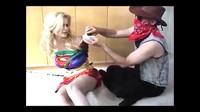 Busty Blonde Supergirl In The Hands Of Desperado