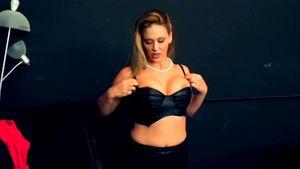 Busty Blonde Black Widow Captures Villain In Her Web